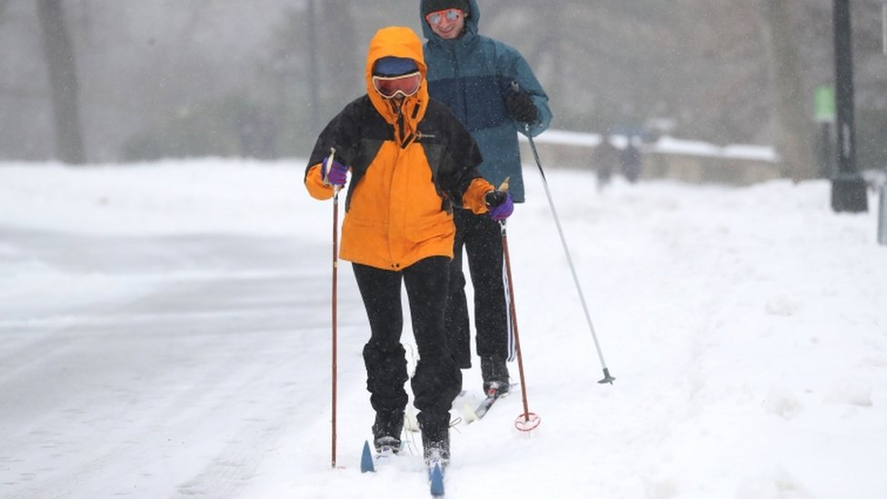 Skiers explore the fresh snow in New York's Central Park