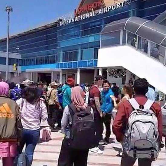 People evacuate from Lombok International Airport after an earthquake in this still image obtained from a social media video