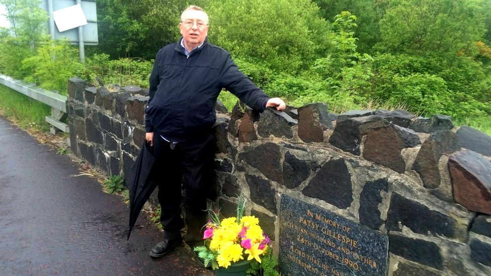 Historian Dr Billy Kelly standing by a memorial to Patsy Gillespie killed by an IRA bomb he'd been forced to drive into the British checkpoint