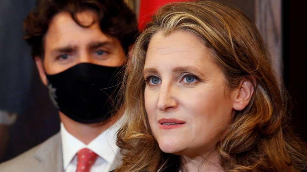 Finance Minister Chrystia Freeland speaks to reporters next to Prime Minister Justin Trudeau in Ottawa,