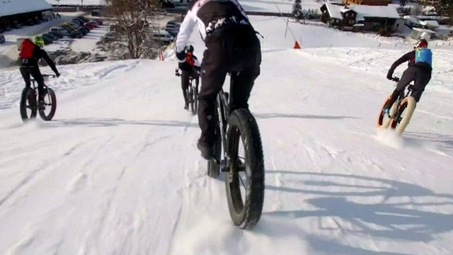 Bikers brave ice and snow for a high-speed race through the Swiss mountains.
