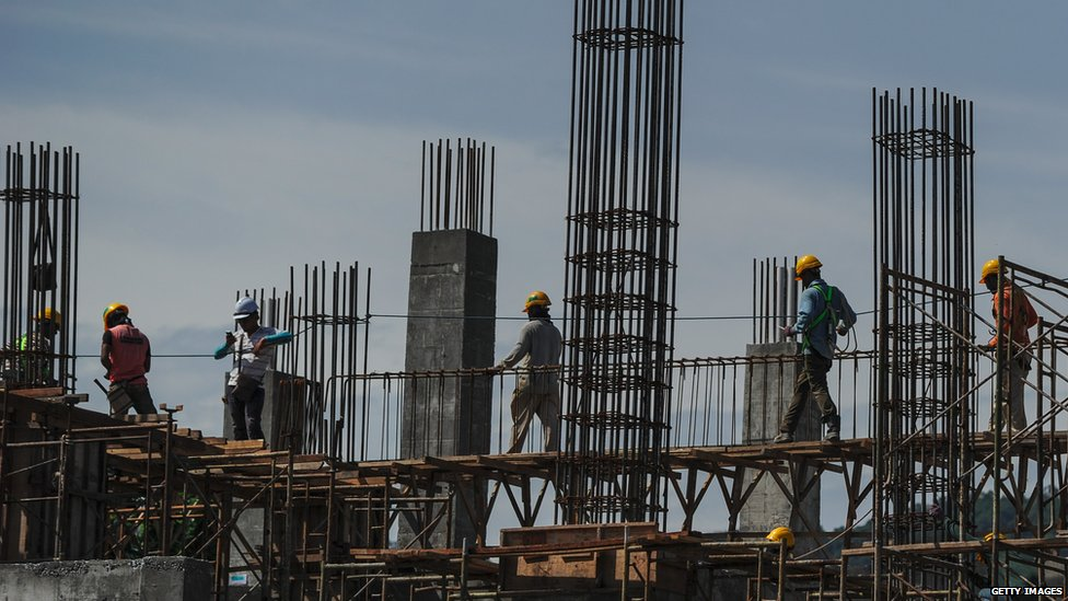 Construction workers in Kuala Lumpur: Malaysia's economy is likely to feel the fallout from this week's events