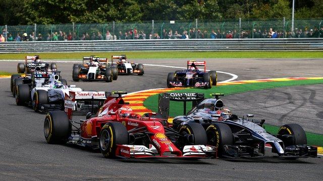 Kimi Raikkonen fights with Jenson Button at Spa-Francorchamps