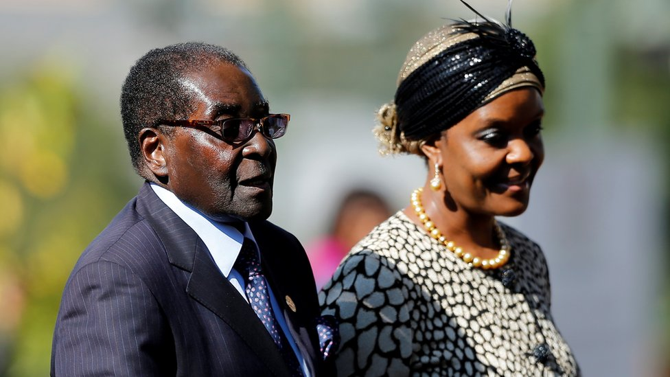 Zimbabwean President Robert Mugabe (L) with his wife Grace in a file photo taken in South Africa in 2014