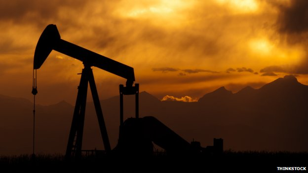 Oil well in dramatic landscape