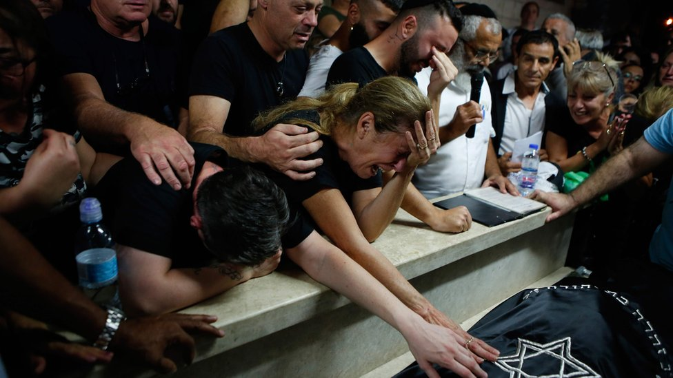 Mourners at the funeral of Kim Levengrond Yehezkel, an Israeli woman who was shot at the Barkan Industrial Zone in the occupied West Bank on 7 October 2018