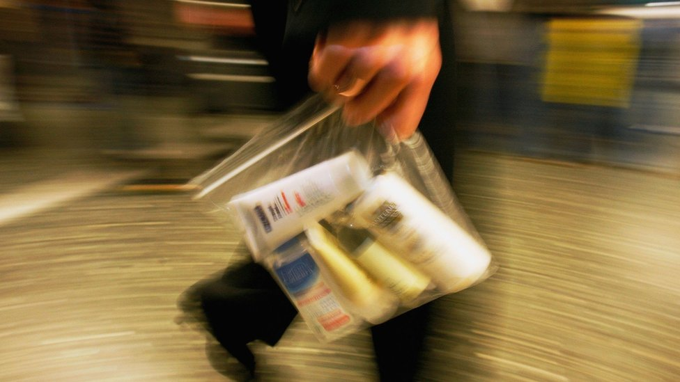 Air traveller with liquids in plastic bag