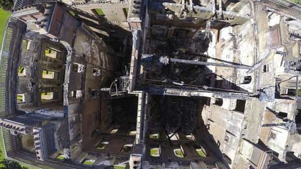 Aerial view of burnt-out mansion