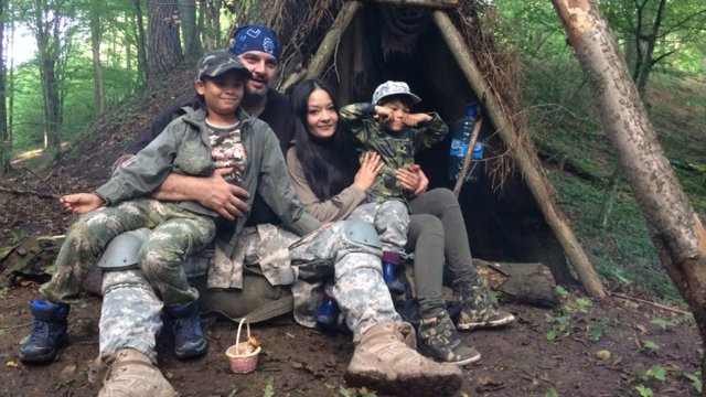 Piotr Czyrullo and family in the forest