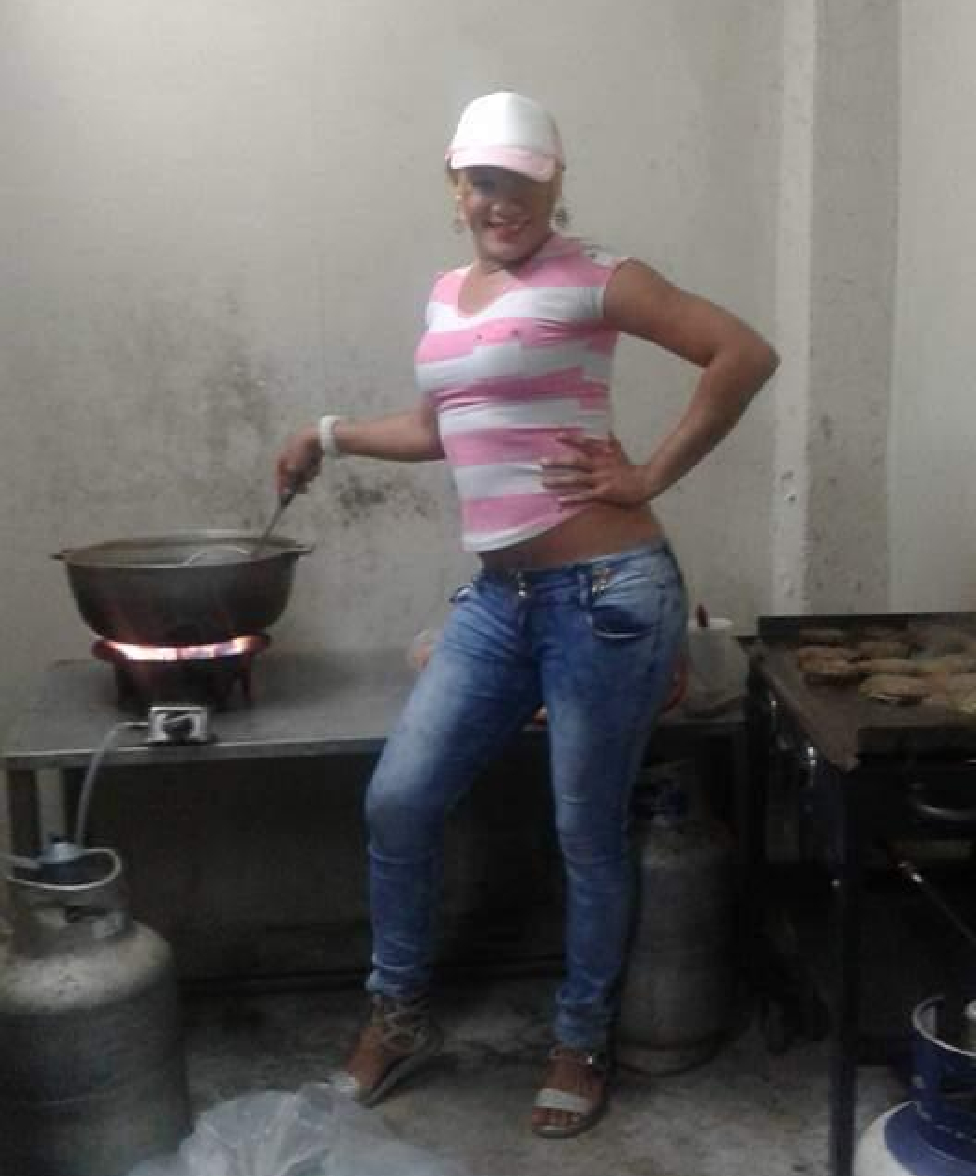 Monica cooking on a stove