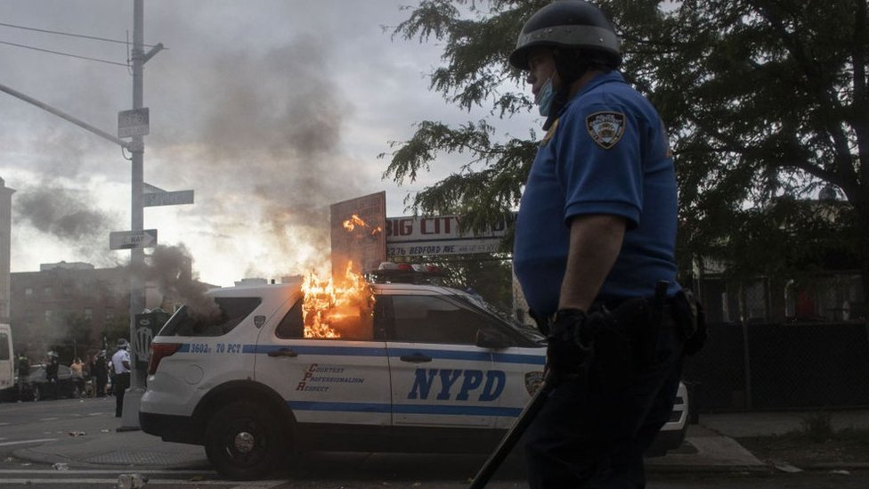 A burning police car in New York