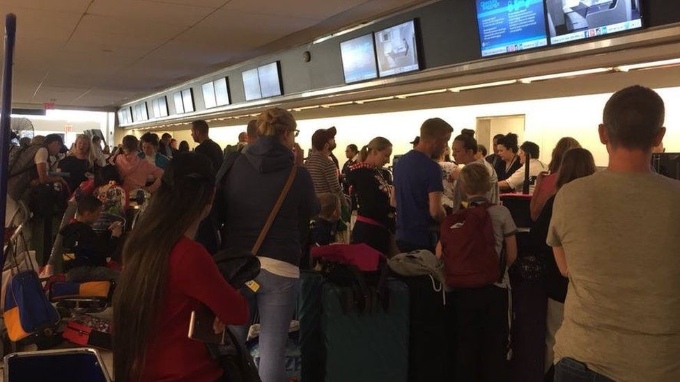 Passengers for BA flight 2036 queue up to board for a third time