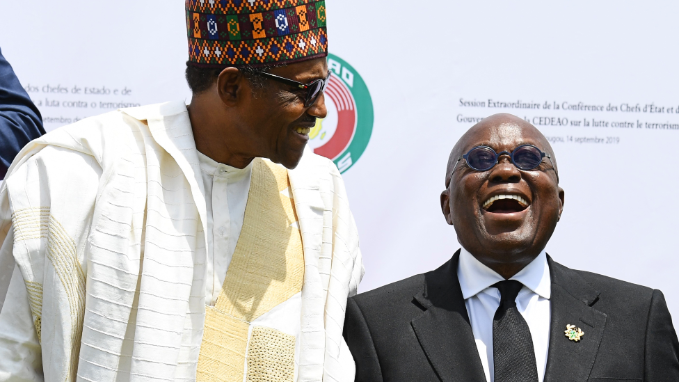 Presidents Muhammadu Buhari of Nigeria and Nana Akufo-Addo of Ghana pose after the opening ceremony of an Ecowas meeting in Burkina Faso 14 September 2019