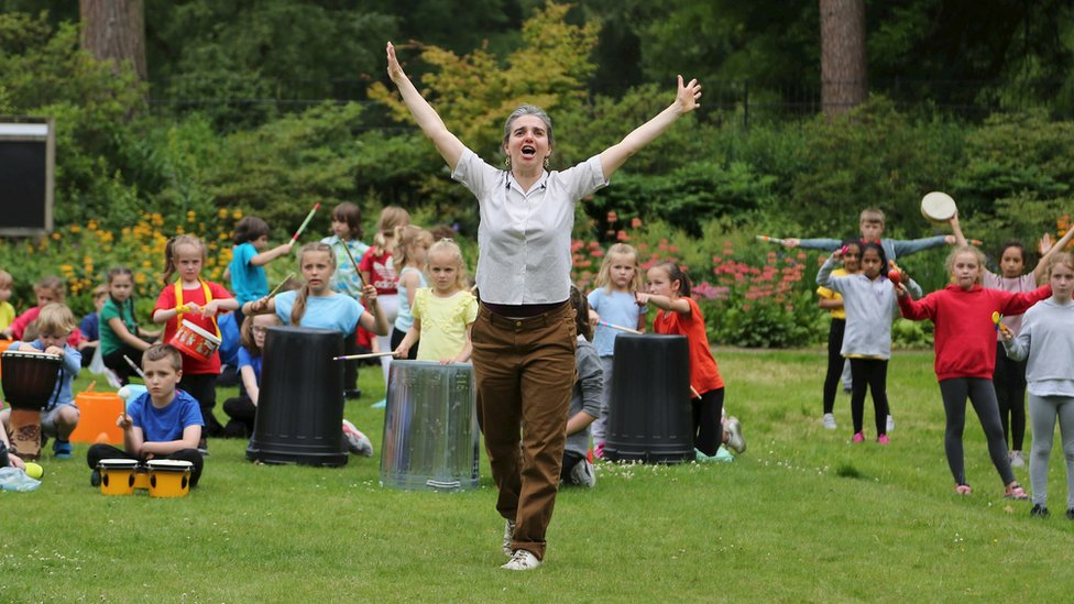 Grace Surman with children drumming at Quarry Bank Mill