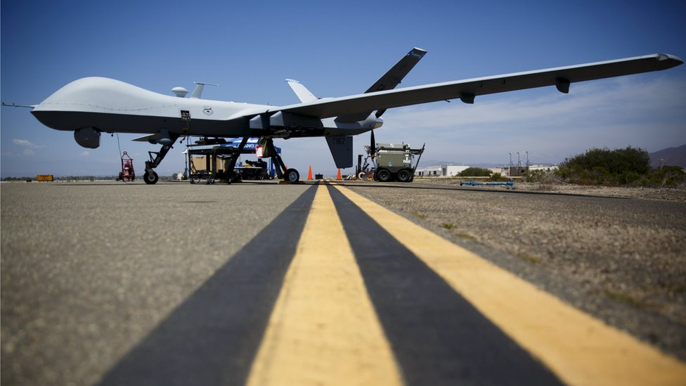A General Atomics MQ-9 Reaper stands on the runway in California