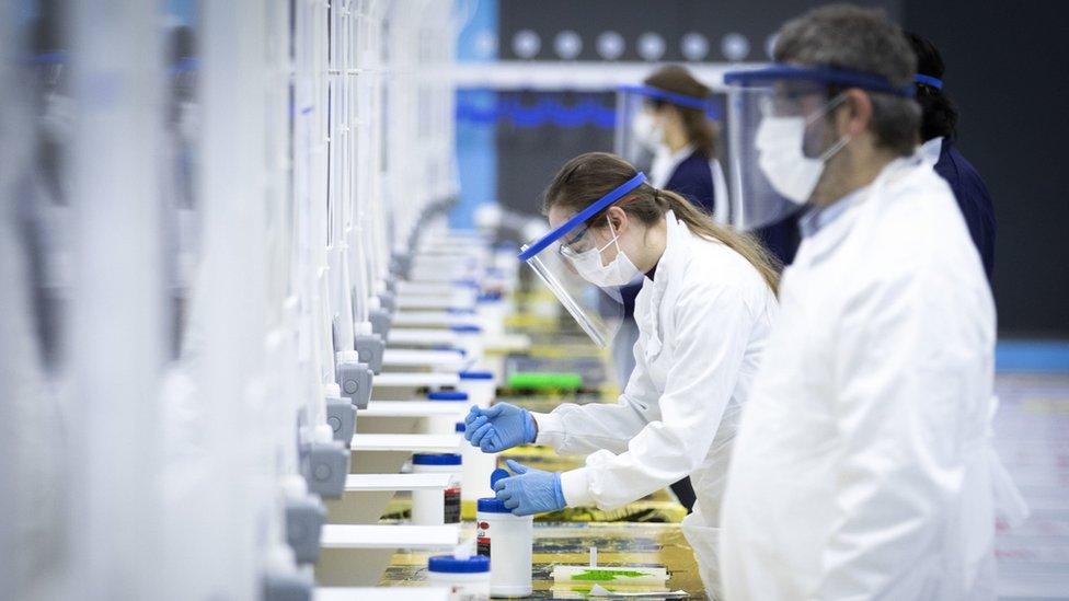 Staff at a coronavirus mass-testing centre
