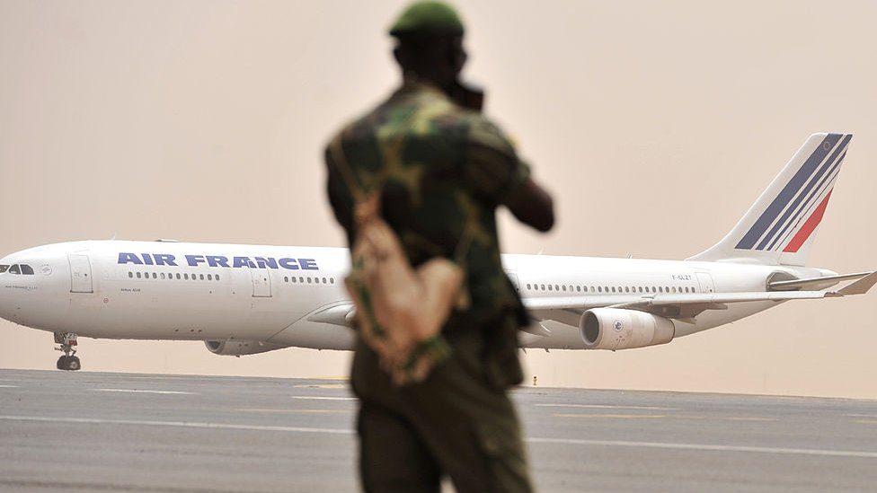 A Malian soldier watches as an Air France aircraft taxis at Bamako airport on March 29, 2012.