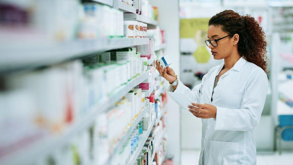 A pharmacist sorting medicines