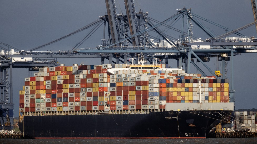 A container ship docked at Felixstowe port last month, stacked high with containers