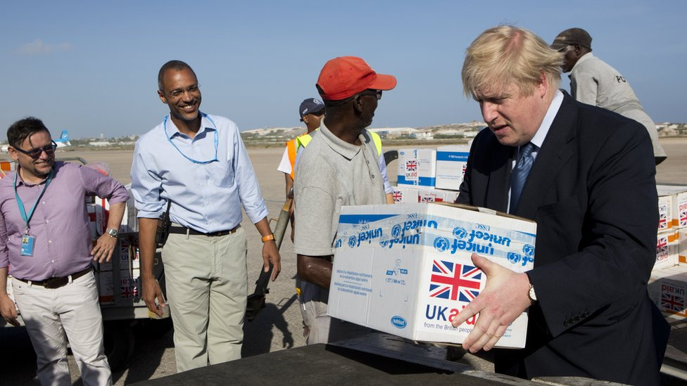 Boris Johnson helping to load supplies onto a cargo plane at Aden Adde International Airport, in Mogadishu, Somalia