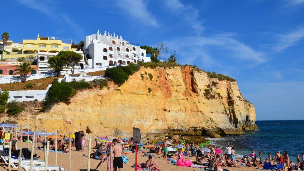 Tourists in the beach in Carvoeiro, Algarve, Portugal