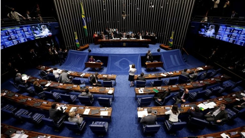 Members of Brazil's Senate, in favour and against the impeachment of President Dilma Rousseff, participate in the debate leading up to the voting in Brasilia, Brazil, May 11, 2016