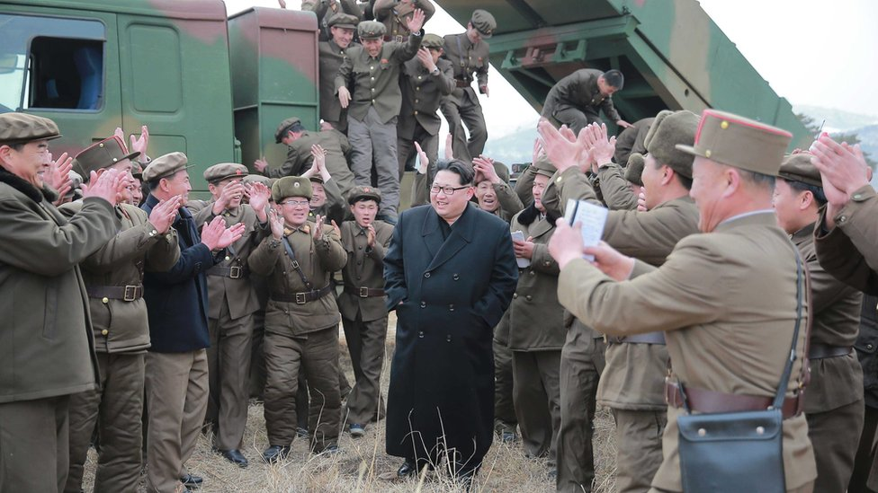"""Kim Jong Un, supreme commander of the Korean People""""s Army, meeting millitary personnel during the test-firing of new-type large-caliber multiple launch rocket system. Picture made available 4 March 2016"""