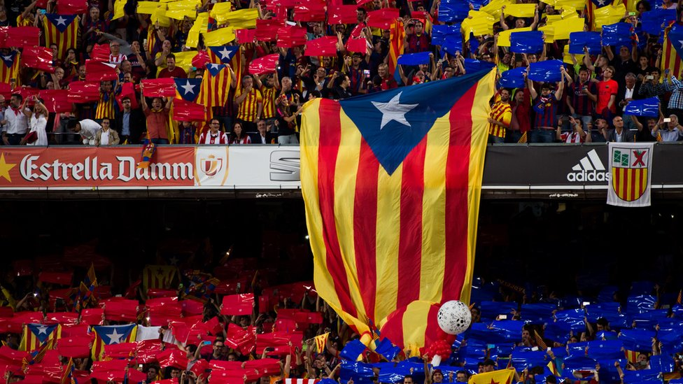 A pro-independence of Catalonia flag is shown by supporters of FC Barcelona as Spanish National Anthem is played before the Copa del Rey Final between Athletic Club and FC Barcelona at Camp Nou on May 30, 2015 in Barcelona, Spain