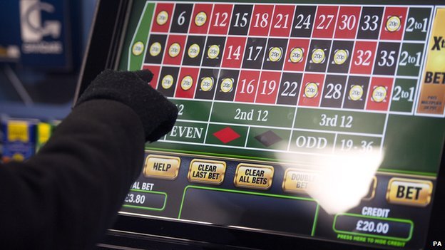 A punter tries out a fixed-odds betting terminal