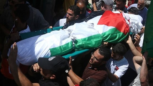 Saad Dawabsha's body was carried atop a crowd of hundreds of mourners