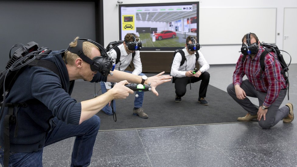 Audi workers wearing VR headsets