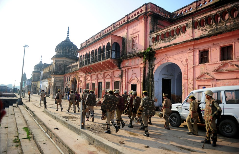 Indian police on patrol near a temple in Ayodhya in 2013