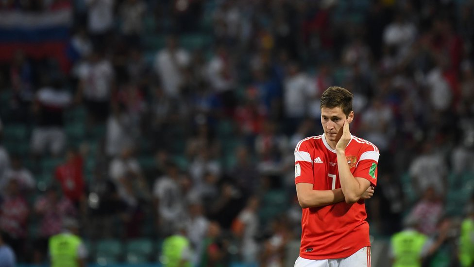 Russian midfielder Daler Kuzyaev reacts after the team lost their Russia 2018 World Cup quarter-final match to Croatia, 7 July 2018