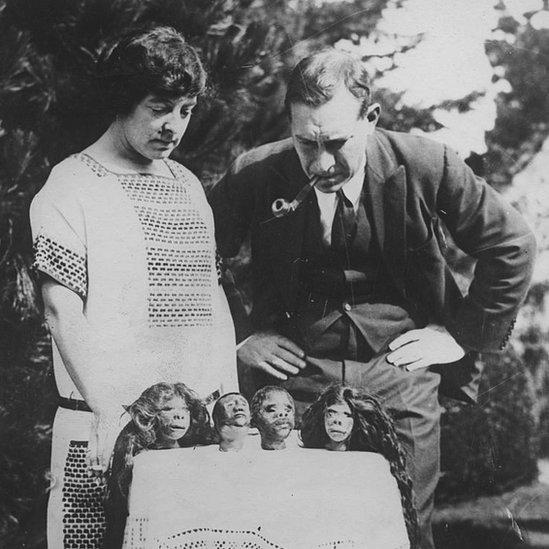 British explorer Lady Richmond Brown reviews her collection of shrunken heads, obtained from the Tibolo and Jivaro tribes of South America, circa 1925.