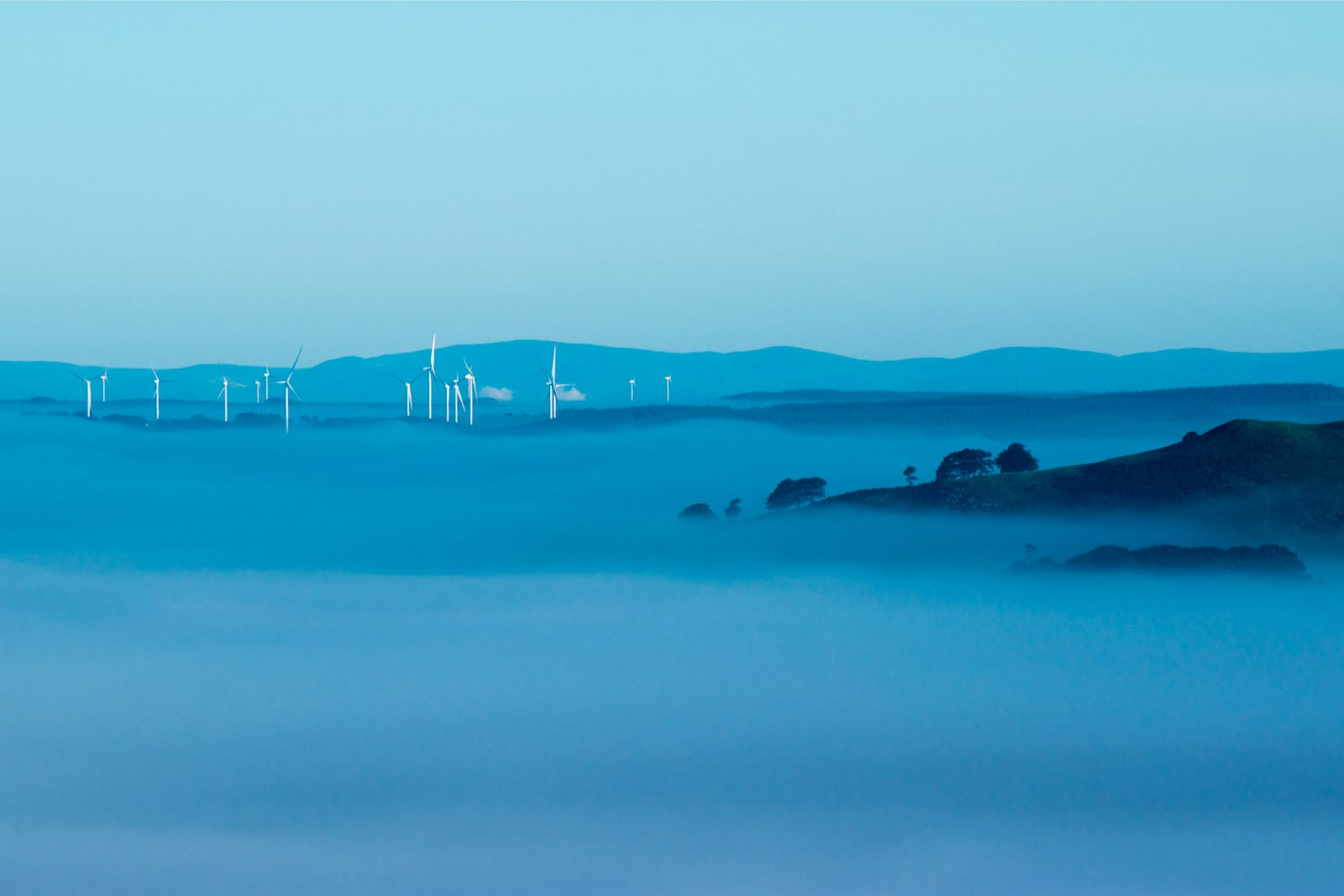Windmills in mist