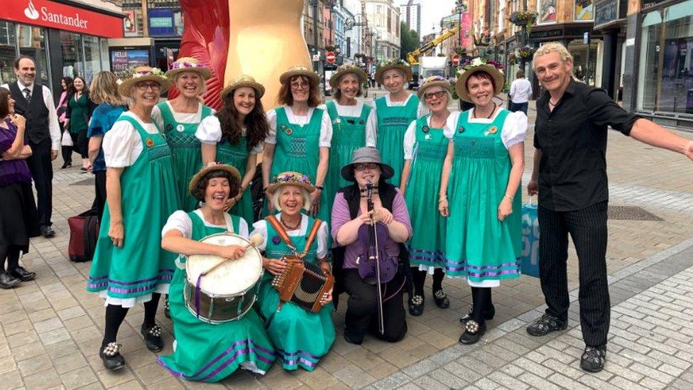 Paul with folk musicians