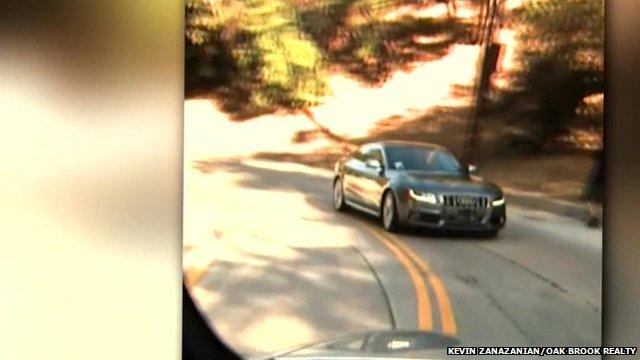Car driving backwards on LA's Mulholland Drive - Kevin Zanazanian/Oak Brook Realty