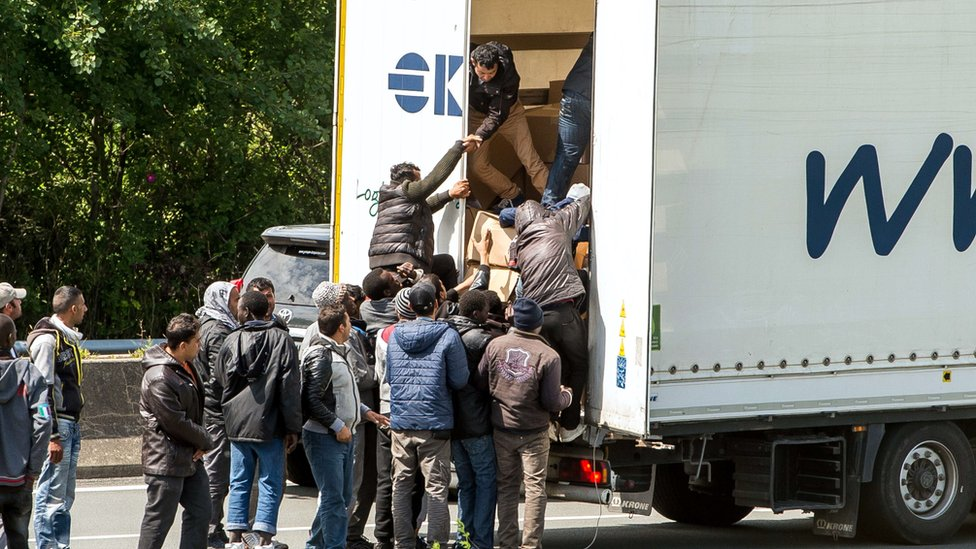Migrants getting onto a truck heading for the Eurotunnel