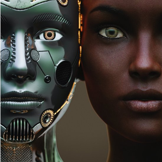 Female robot and human heads side by side