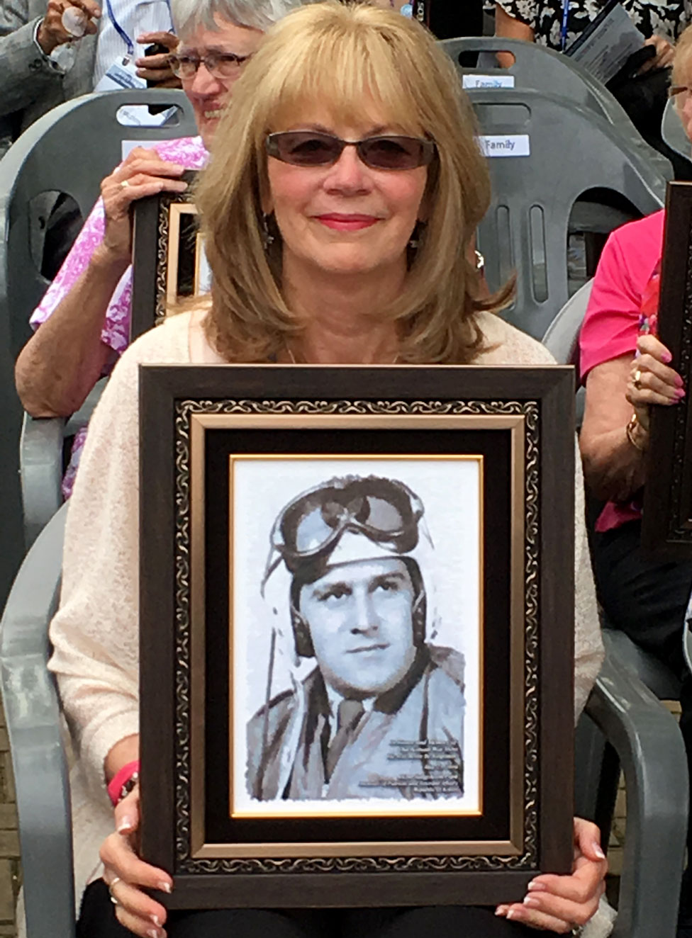 Diana Sanfilippo with a picture of her father
