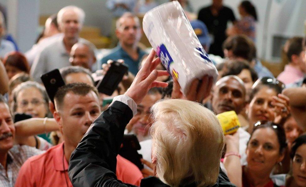 Trump handing out goods