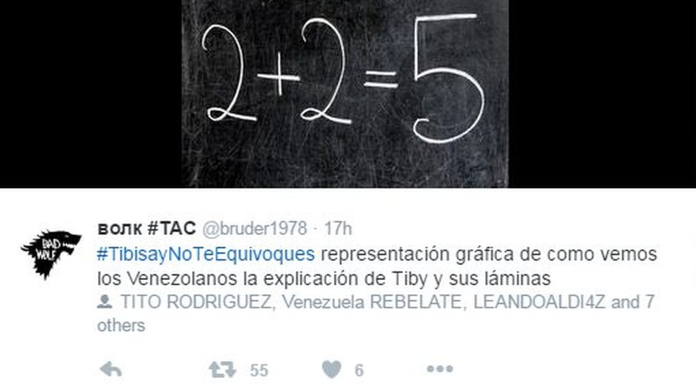 A screen grab of a tweet showing a blackboard and the equation two plus two equals five.