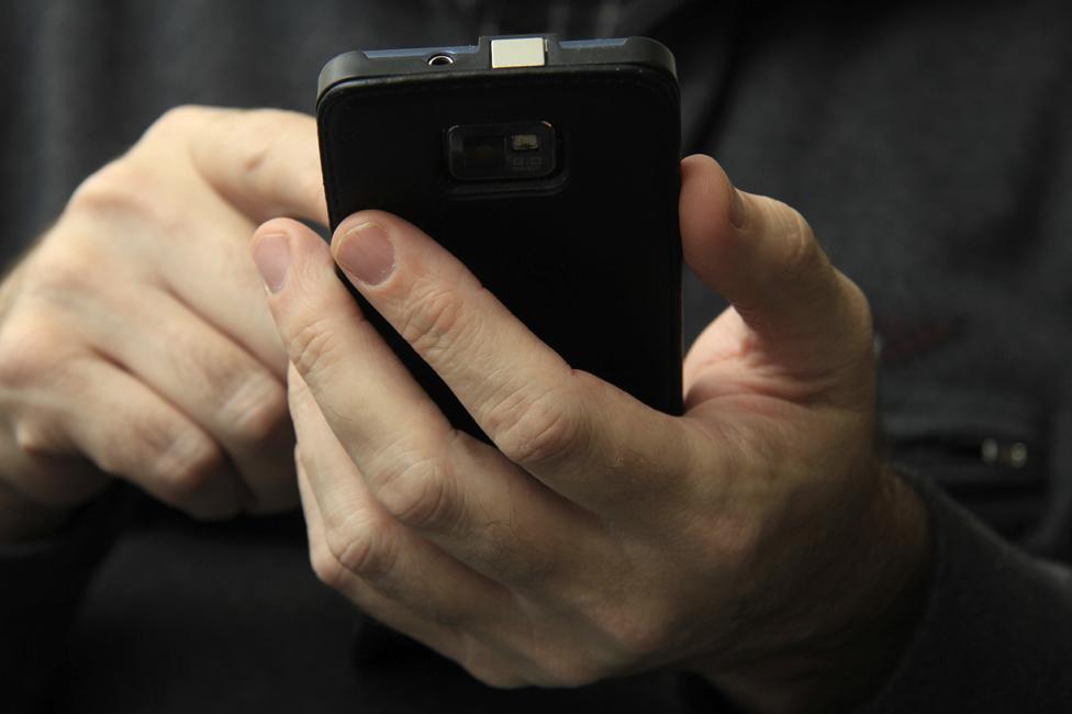 Detail of man using smartphone
