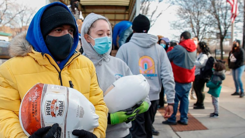Volunteers giving out turkeys ahead of Thanksgiving in Chicago, Illinois