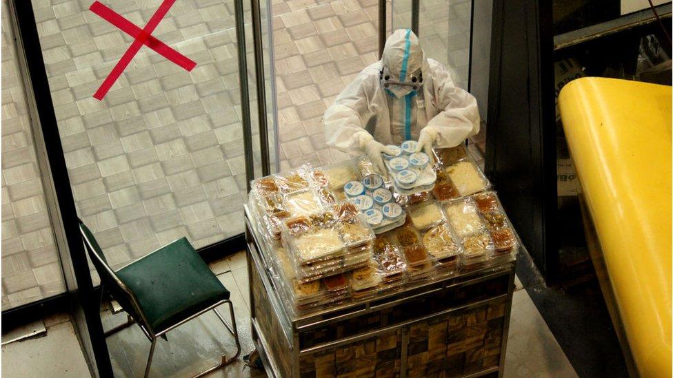 A ward boy with food trolley