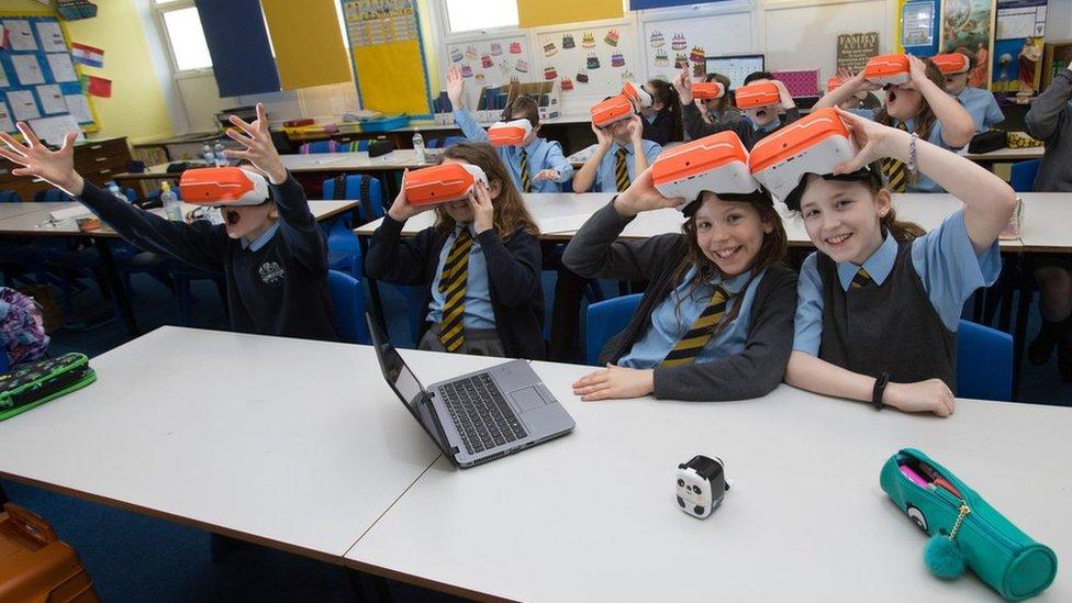 Pupils wearing VR headsets