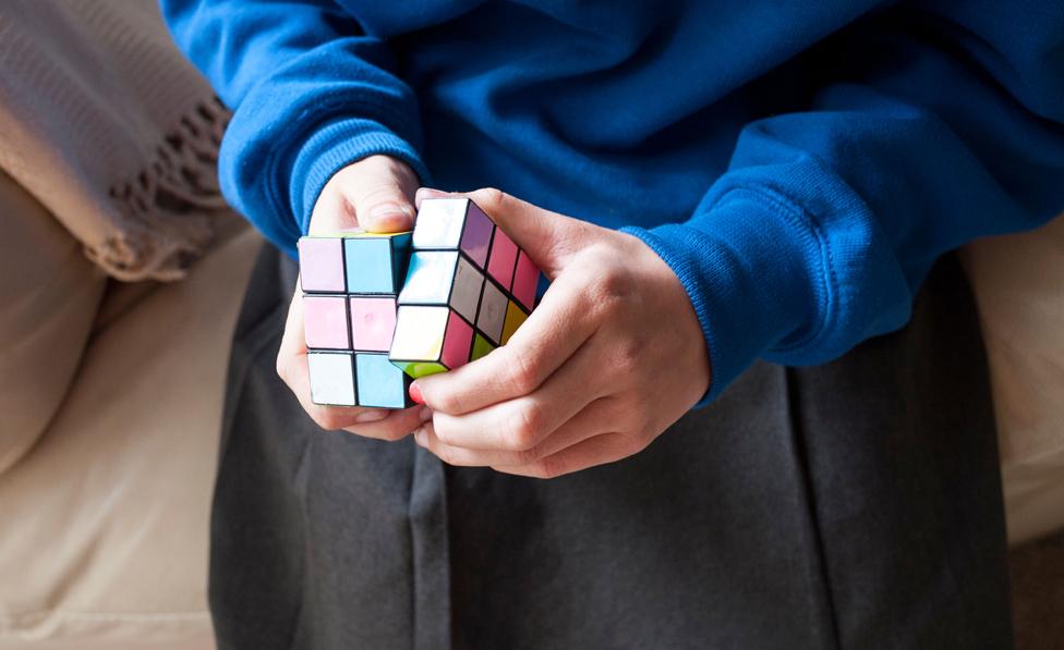 Child doing Rubik's cube
