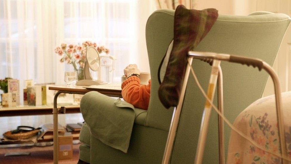 Elderly man sitting in a chair