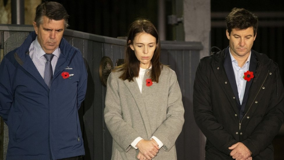 New Zealand Prime Minister Jacinda Ardern stands at dawn on the driveway of Premier House with her husband and father