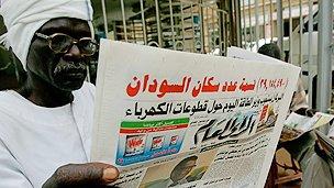 Newspaper reader in Sudan